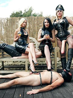 Local femdom ladies are having a backyard party bringing slaves with them and having a lot of fun
