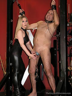 Male slave is exposed in bondage and is about to suffer many unpleasant minuted when girl is going to torture his cock and balls