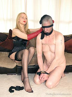 There is a kneeling slave erotic blond have to humiliate with her sexy legs and tease with footjot