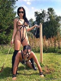 Petboy is out in the field riding sexy Goddess on his back. The girl is wearing nothing but sexy BDSM harness