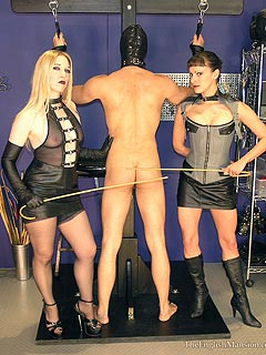 Caned slave is thanking the girls who punished him by kissing their feet