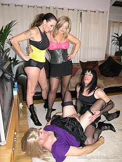 A couple of femdom ladies are enjoying the way feminized slaves are fucking each other in the ass