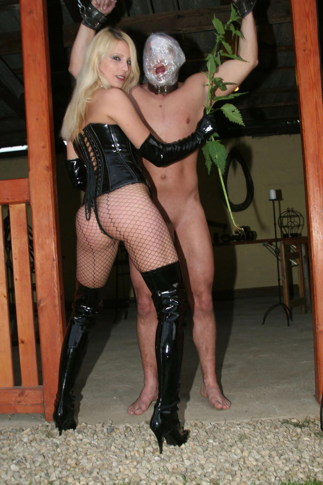 Hot blond naked dominatrix guide - Lady bound slave's head with plastic and whipping his exposed ...