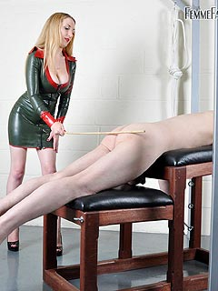 Green latex dress caning torture