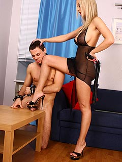Blonde Goddess is using a whip to put nude male into submission and make him worship her heavenly sexy feet