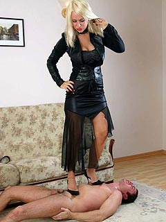 Hotblond is tired of trampling her slave: taking high heel shoes off so he could lick and suck her toes