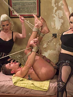 A team of two mean girls are using extreme BDSM approach to train that man into silent femdom doll