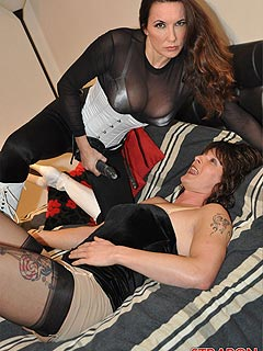 Strap-on domme is making sure sissy cross-dresser is taking her big strap-on cock into every hole he has