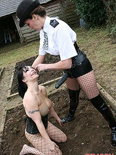 Domme in police uniform is putting dirty slut in submission by using big strap-on