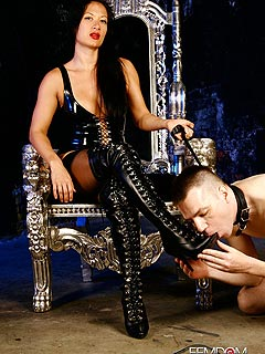 It is nice for a girl to sit on her throne and enjoy a kneeling man cleaning her knee-boots with licking