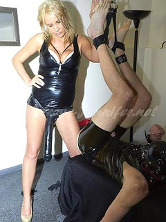 Strap-on blond is rewarding slave with handjob after destroying his ass with cruel anal sex