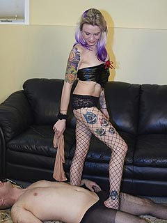 Leggy babe in heels is making sure trampling torture is bringing maximum pain to the exposed slave underneath