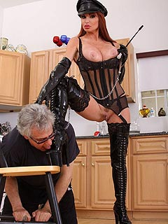 Busty bitch is wearing military-style fetish clothing when educating an old man to polish her boots and worship ass