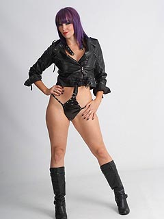 Erotic mistress is combining PVC lingerie and leather in her fetish outfit