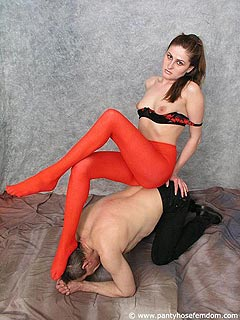 Smothering mistress is doing it topless and in bright red pantyhose