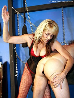 Cruel femdom session has began with the blond plugging a toy into slave ass and then spanking it hard