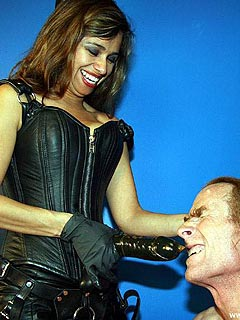It is fun for the MILF mistress to push a strap-on into slave throat turning him into a cock-sucking sissy